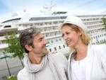 14024060-happy-romantic-couple-standing-in-front-of-cruise-boat[1]